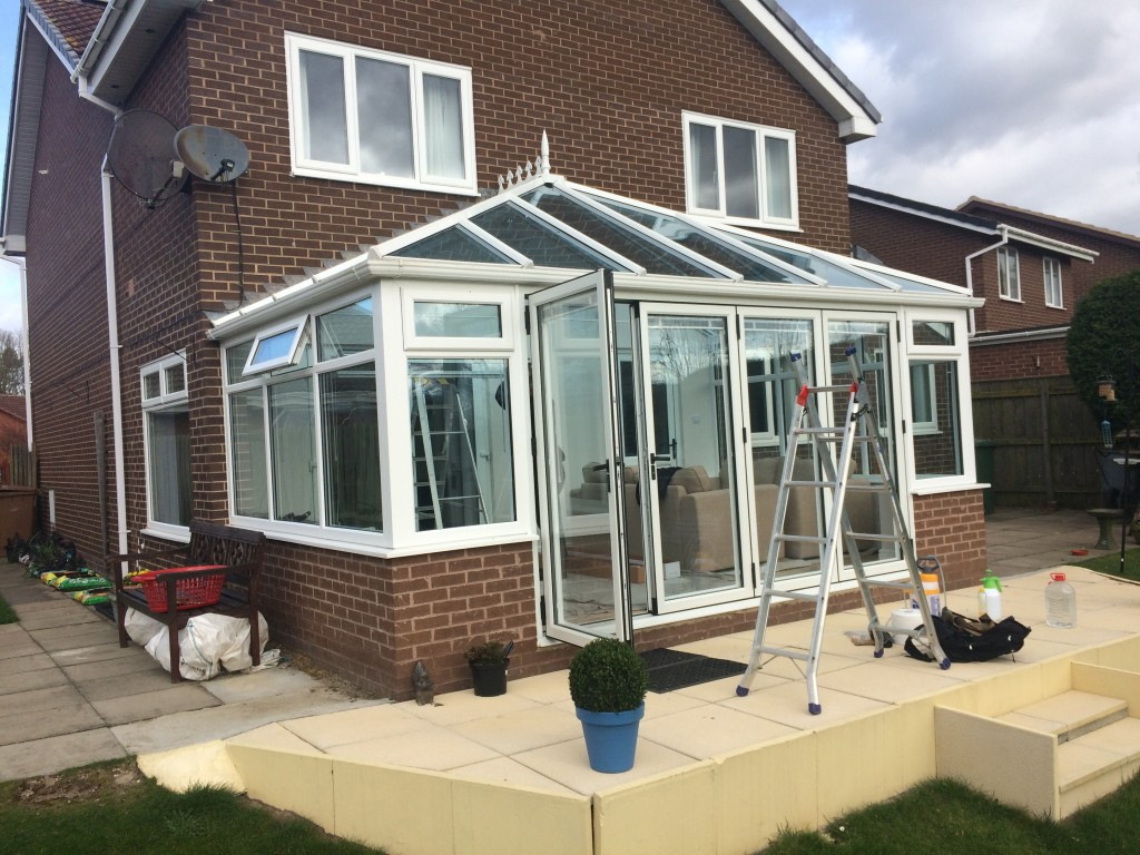 Installing Reflective Silver 20 To A Conservatory In